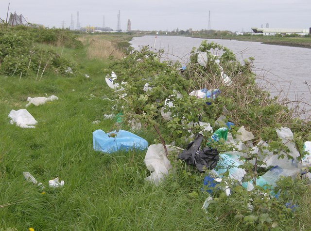 plastic dumped by river