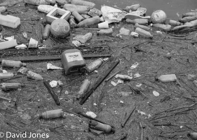 Plastic-pollution-on-a-river-black-and-white